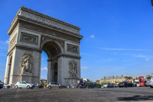 the arc de triomphe supervises the insanity at the roundabout below in paris