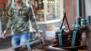 freshly baked cookies adorn a small bakery window in amsterdam