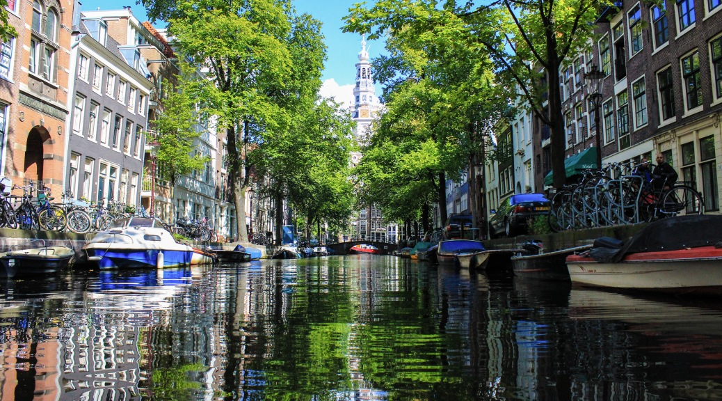 glassy canals in amsterdam
