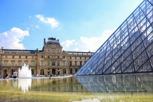 the louvre stares back at itself through its reflection.  paris, france