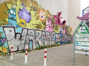 elaborate graffiti adorns a random alley in berlin, germany