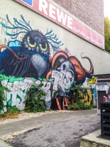 a fierce owl in graffiti keeps watch over his street near hackescher markt in berlin, germany