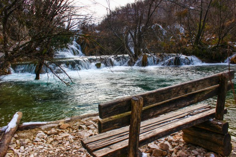 a lonely bench in plitvice national park, in croatia in winter