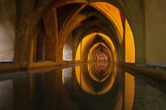bathed in orange light at the alcazar